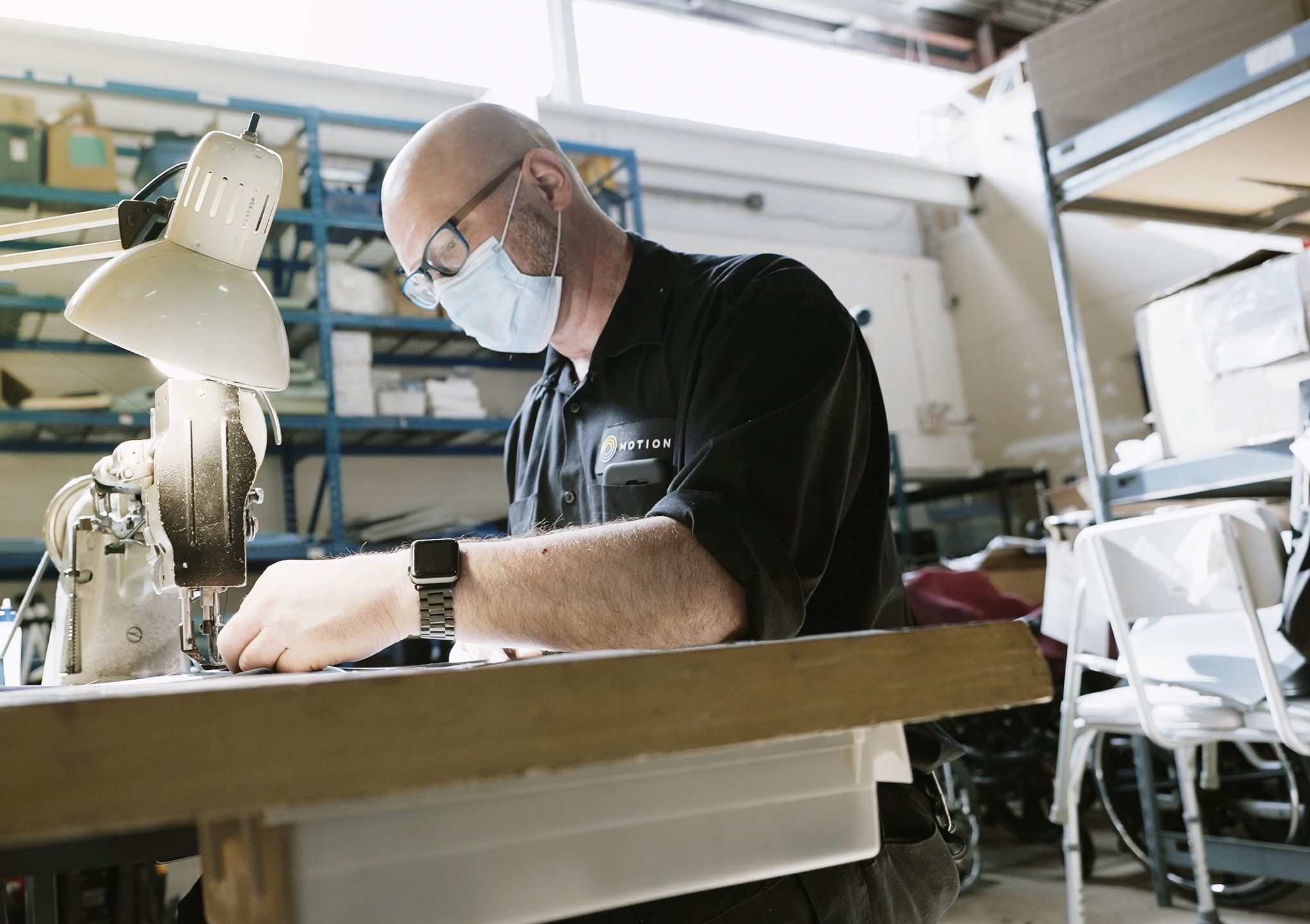 Motion manufacturer working at sewing machine.